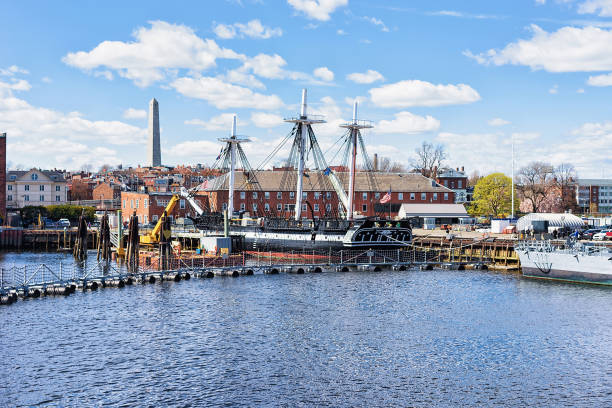 Ship at Charlestown peninsula in Boston MA Ship at Charlestown peninsula and Bunher Hill Monument on the background in Boston, MA, the United States. bomb shelter stock pictures, royalty-free photos & images