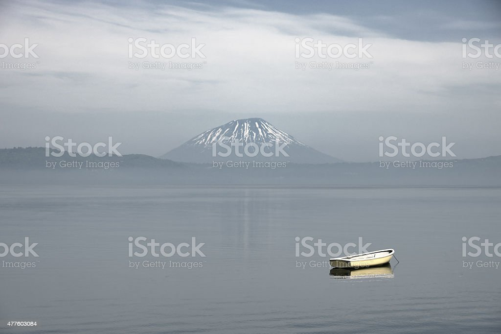ship at lake and mountain Fuji in background stock photo