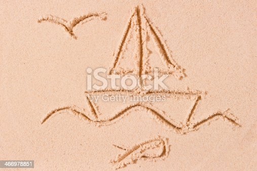 istock ship at sea and seagull drawn on the sand 466978851