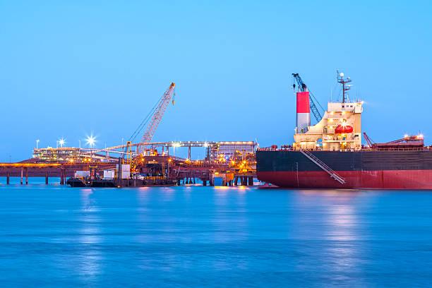 A ship at the docks at sundown stock photo