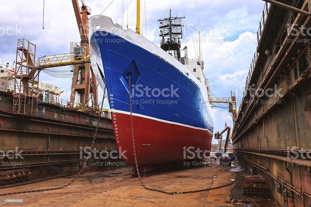 Ship being fixed on a dry dock stock photo