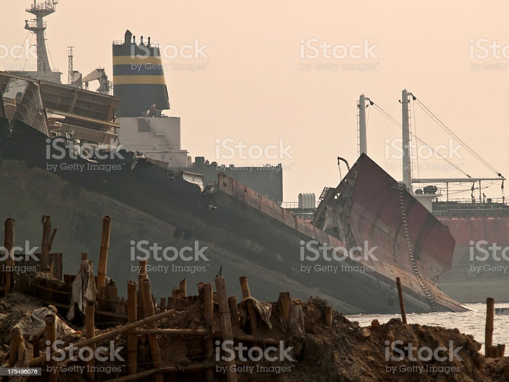 Ship breaking yards through foggy and toxic atmosphere royalty-free stock photo