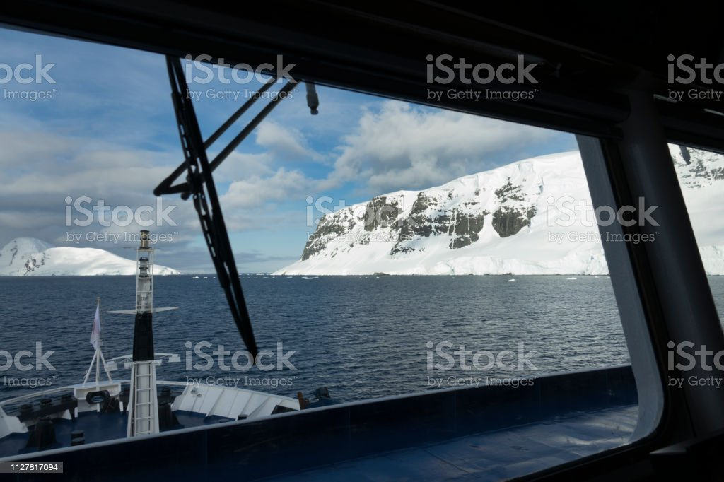 Ship bridge view Wiencke Island Cape Astrup mountains Neumeyer Channel Antarctica stock photo