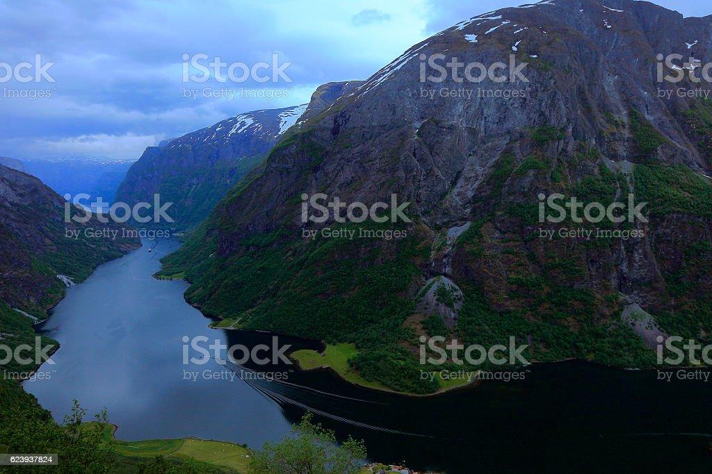 Ship crossing peaceful Nærøyfjord  sunset panorama from above, Norway, Scandinavia stock photo
