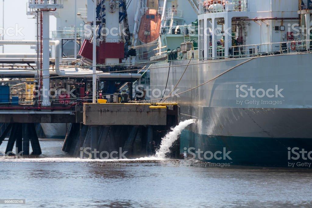 Ship Discharging Ballast stock photo