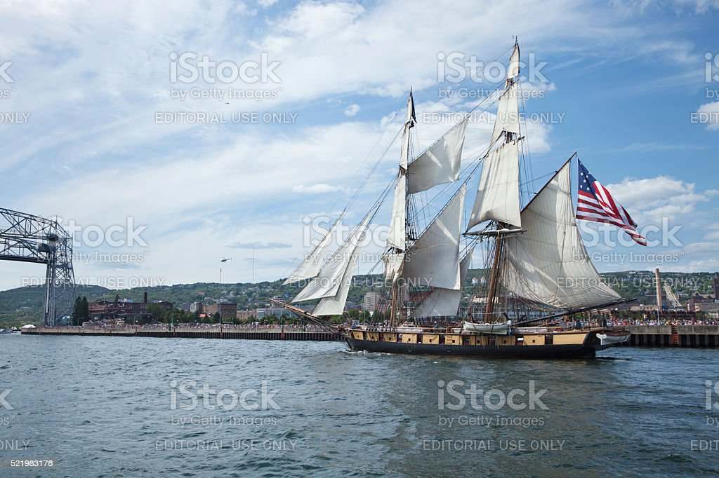 Ship enters Duluth harbor during the Tall Ships Festival stock photo