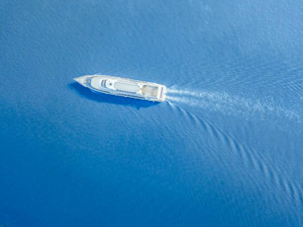 ship ferry in the city river aerial shot - ferry imagens e fotografias de stock