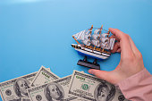 ship floating on waves, made from dollar bills