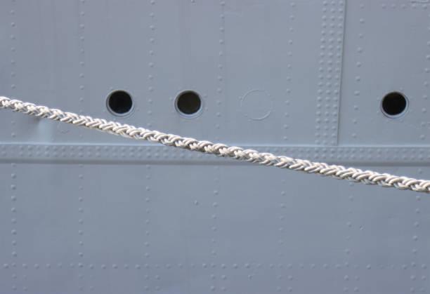 Ship hull and mooring lines. stock photo