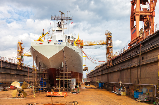 Big ship - rear view with propeller under repair.