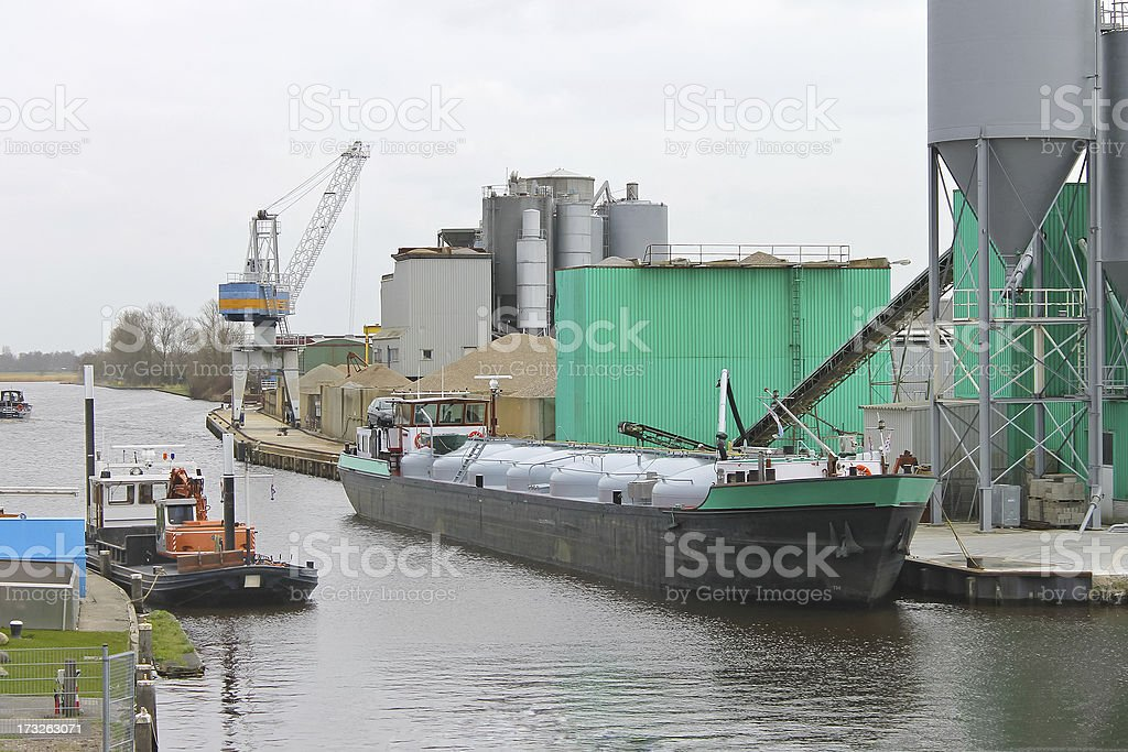 Ship in harbor of the cement plant. Netherlands royalty-free stock photo