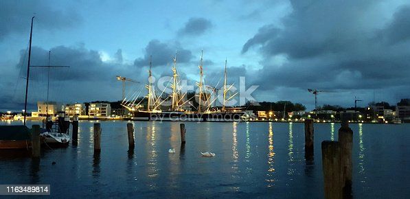Ship at dusk in the harbor