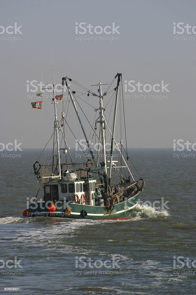 Ship leaving royalty-free stock photo