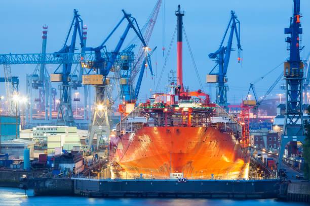 Ship Maintenance in Dry Dock at Dusk, Hamburg Harbor, Germany stock photo
