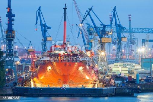 Ship Maintenance in Dry Dock at Night, Hamburg Harbor