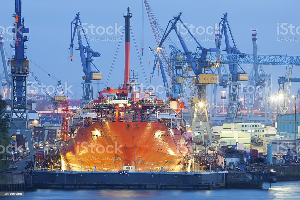 Ship Maintenance in Dry Dock at Night, Hamburg Harbor stock photo