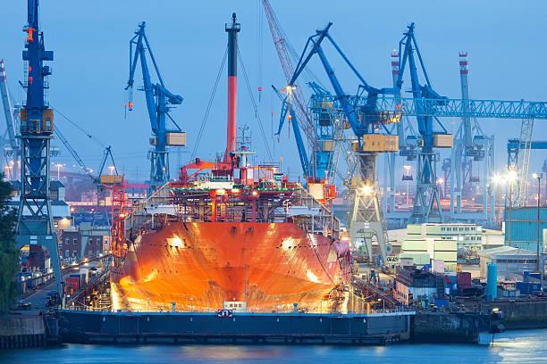 Ship Maintenance in Dry Dock at Night, Hamburg Harbor stock photo