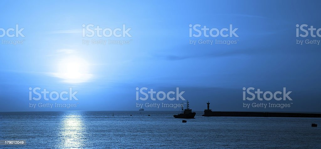Ship moonlit swims in the bay royalty-free stock photo
