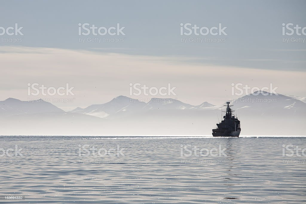 Ship on a calm sea in Svalbard islands, Norway royalty-free stock photo