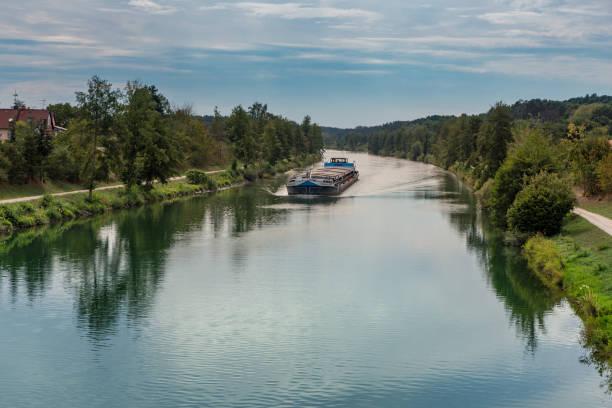 ship on canal in bavaria - main stock-fotos und bilder