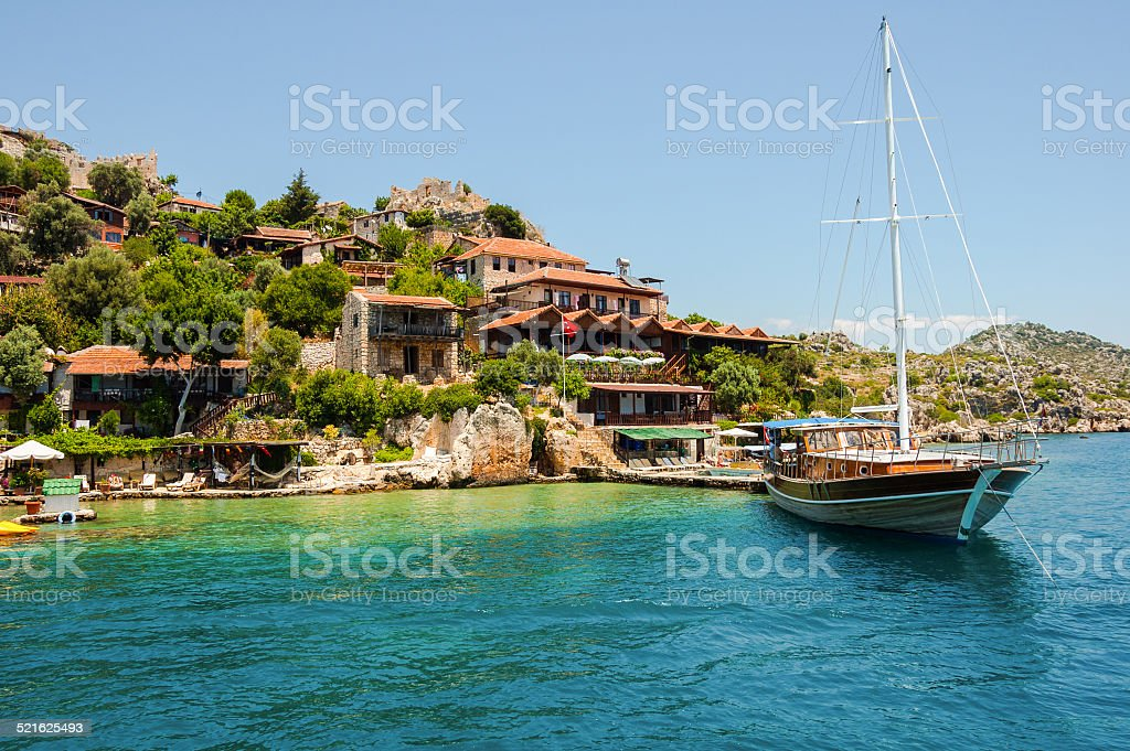 Ship on the background of the coast Kekova stok fotoğrafı