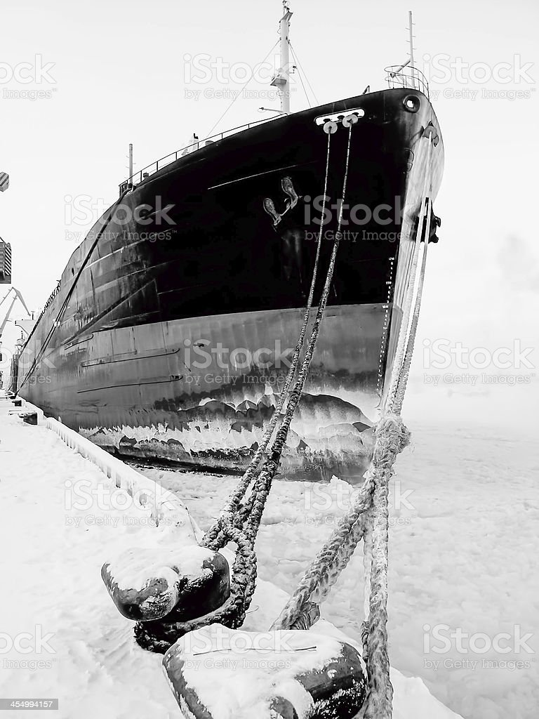 Ship on the Frosted Sea at port stock photo