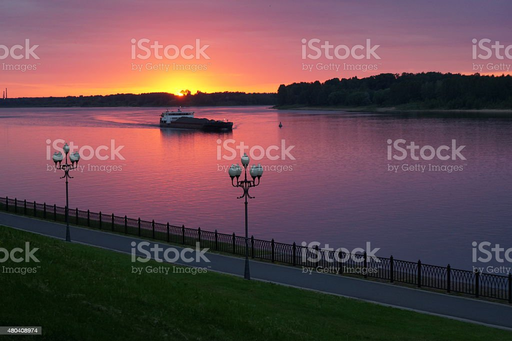 Ship on the river at sunset stock photo