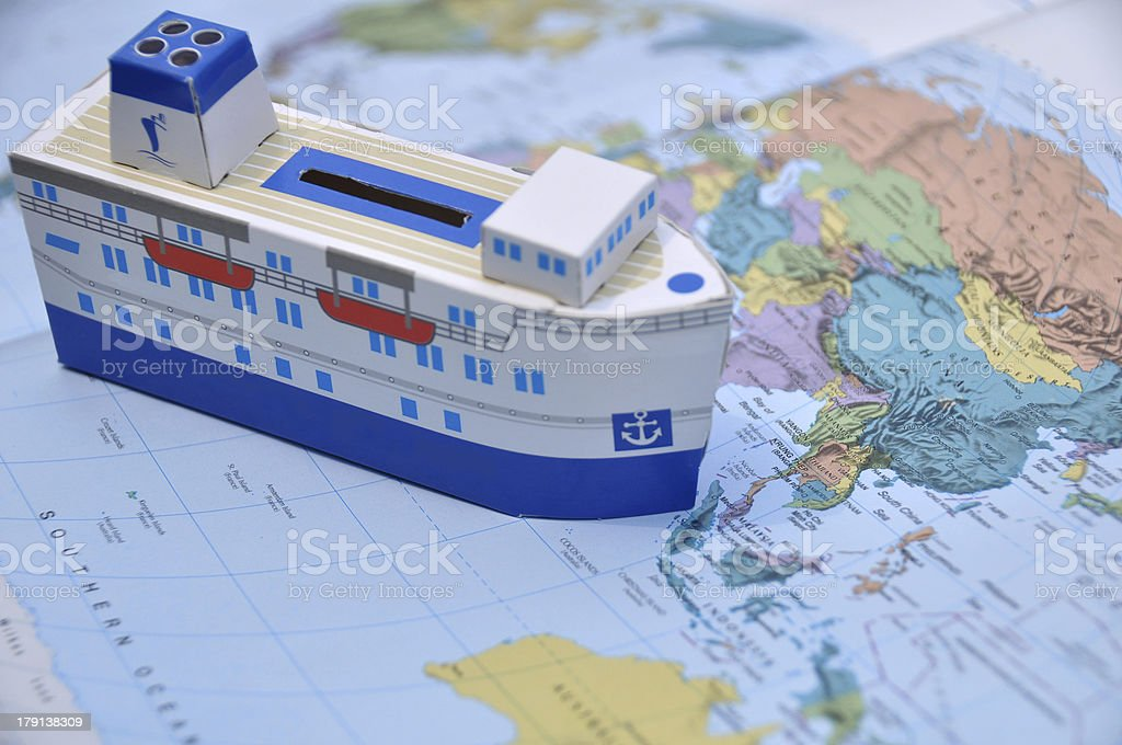 Ship paper model on the world map royalty-free stock photo
