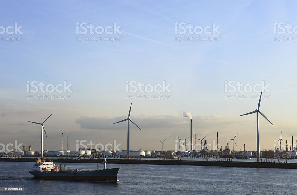 ship passing by a refinery at the Europoort industrial area royalty-free stock photo