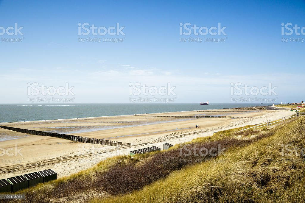 Ship passing by the Beach of Zoutelande stock photo