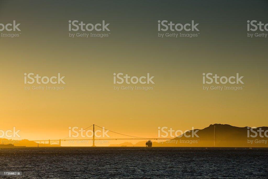Ship passing under the Golden Gate Bridge royalty-free stock photo