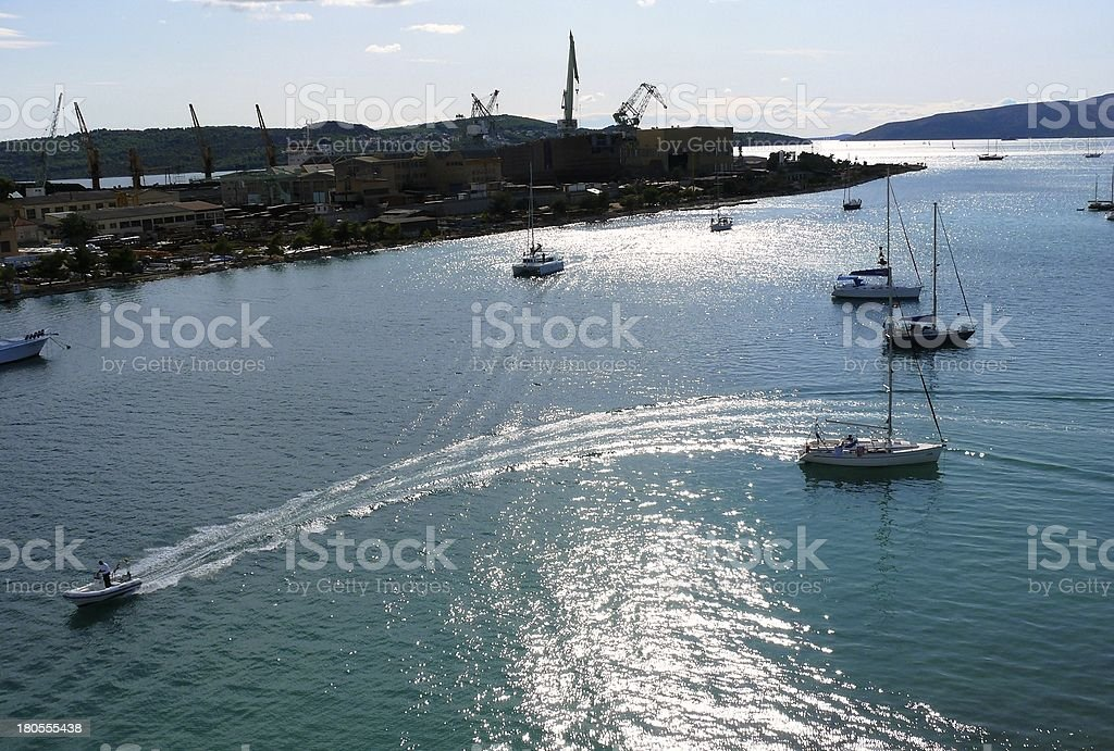 Ship performs a turn and undulates water behind stern stock photo