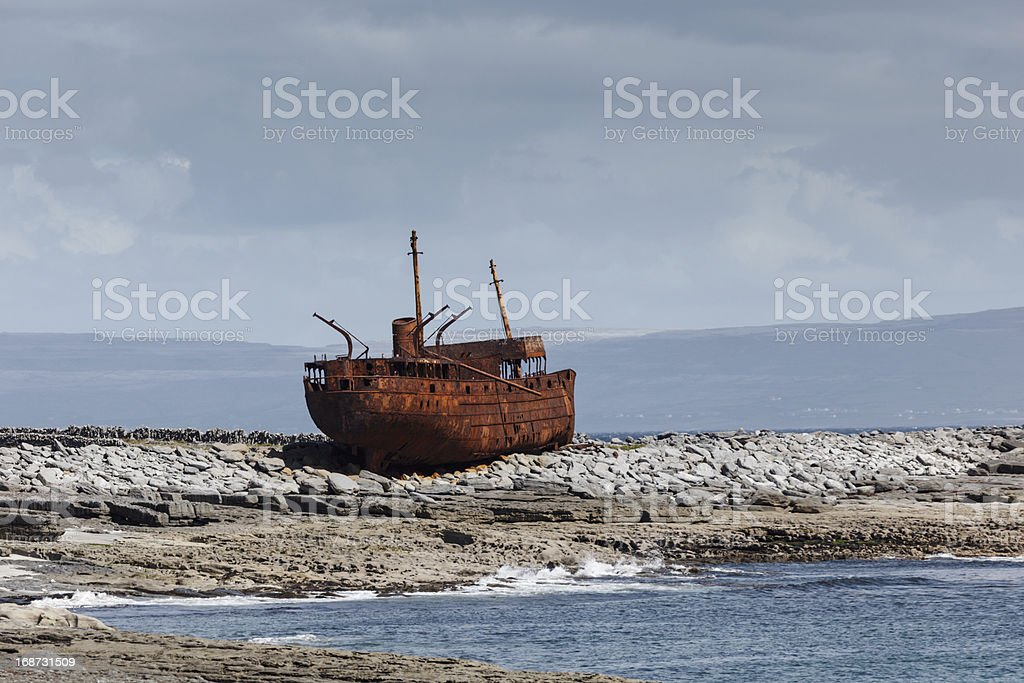Ship Plassey rusted shipwreck hulk on rocks at low tide royalty-free stock photo