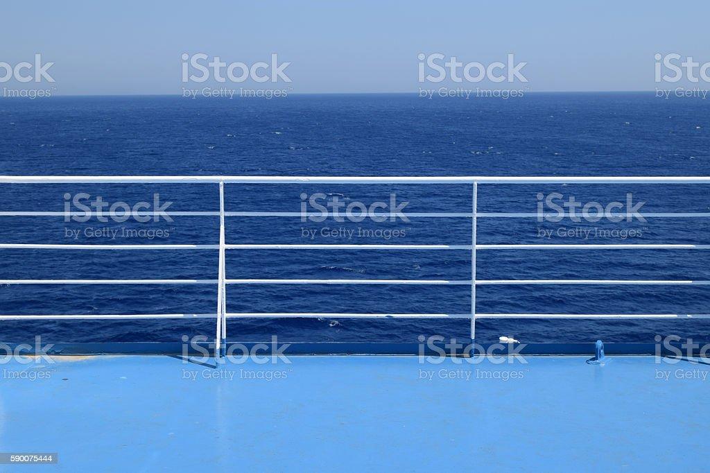 ship railings blue sea stock photo