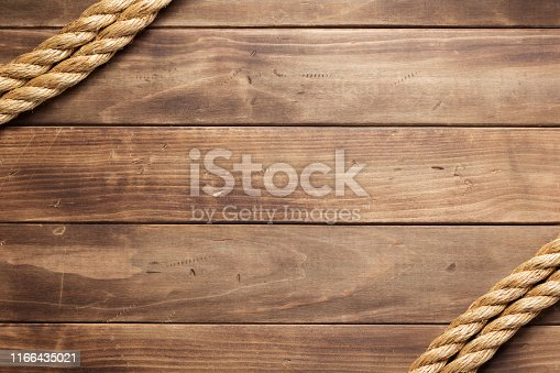 ship rope at wooden board background texture