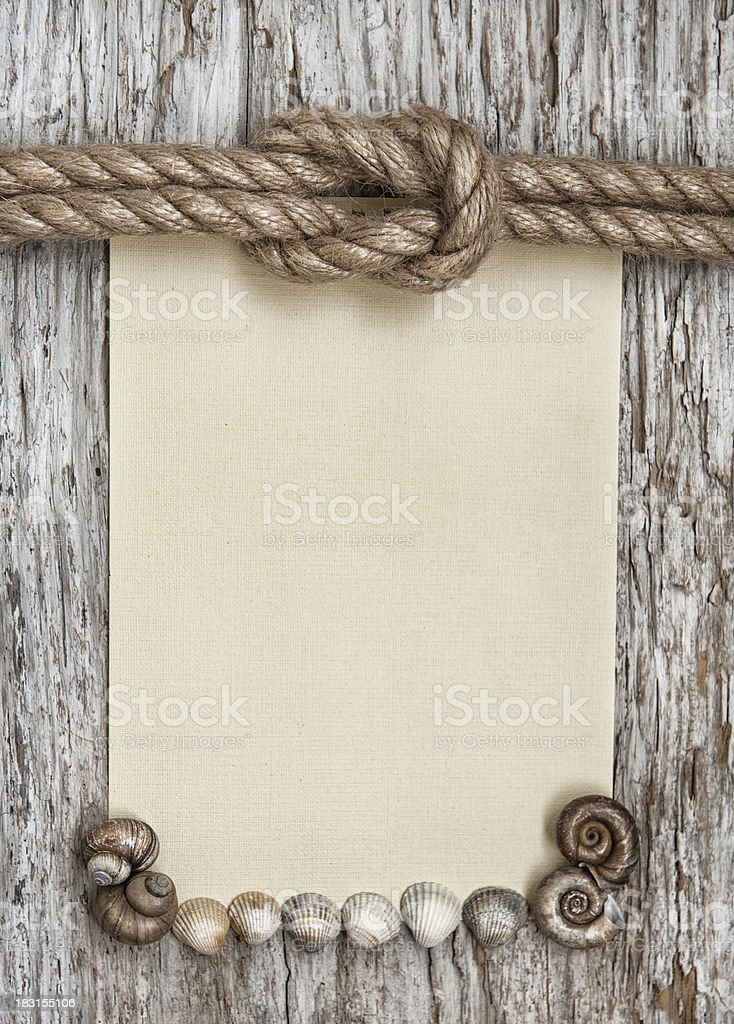 Ship rope, canvas, sea shells and old wood royalty-free stock photo