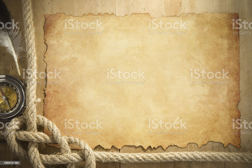 ship ropes and compass at parchment old paper royalty-free stock photo