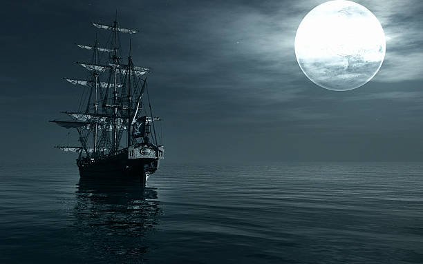 ship sailing at night - pirates stock photos and pictures