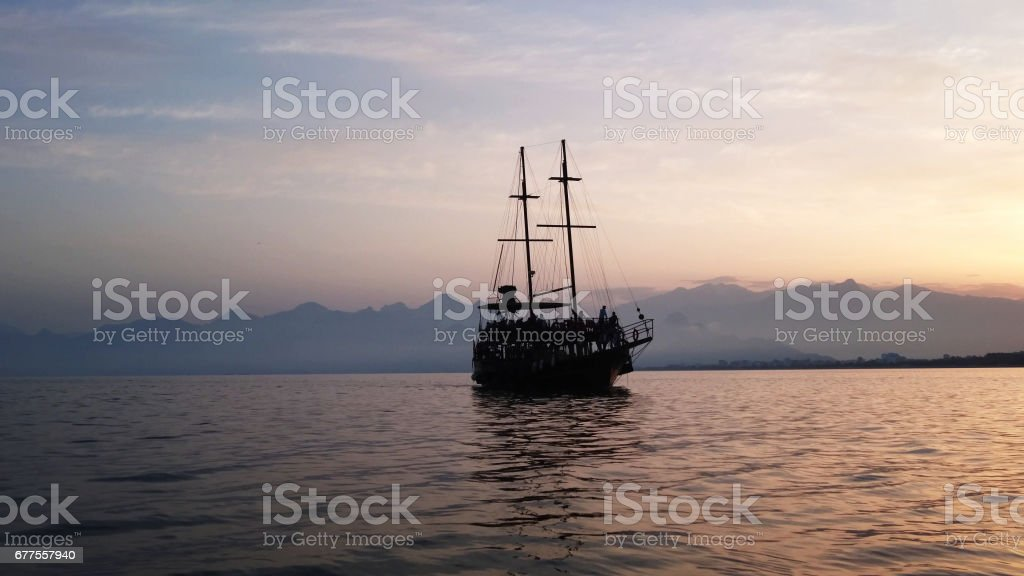 Ship sailing in rough seas on white royalty-free stock photo
