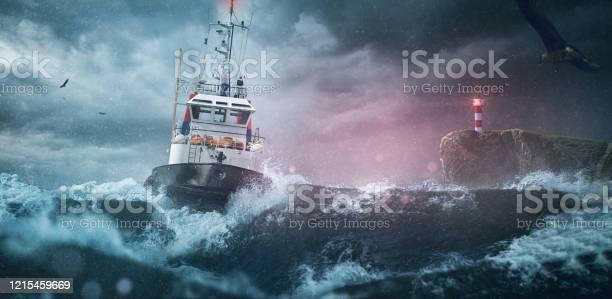 Photo of Ship sea lighthouse storm