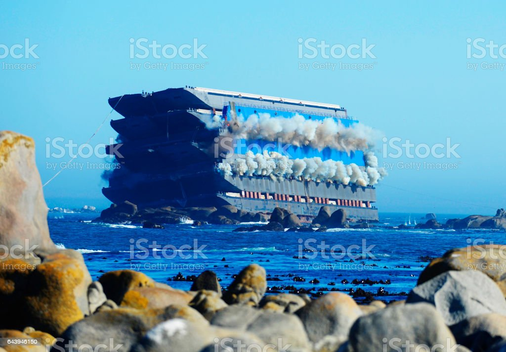 Ship smokes before exploding at sea stock photo