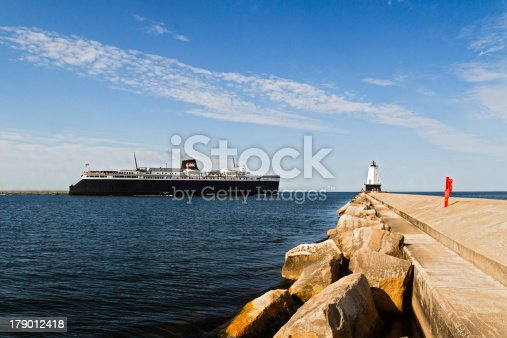 istock Ship Steams Past Lighthouse on Breakwater 179012418