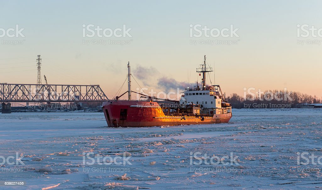 Ship tanker in the river ice. Frosty day stock photo