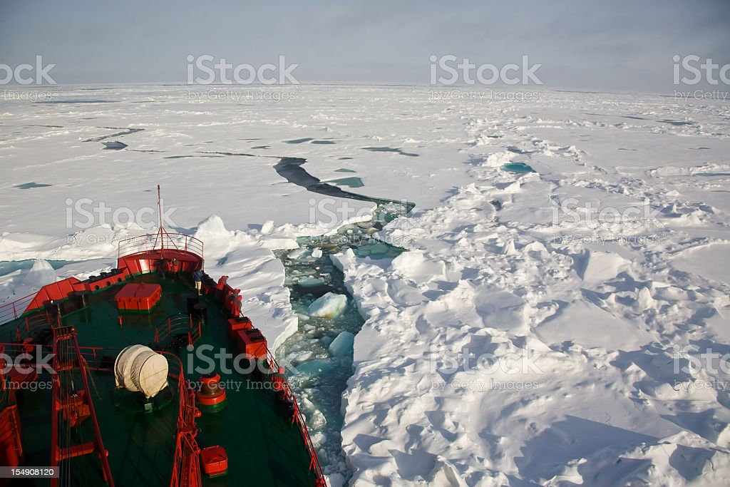 Ship trying to get through frozen Arctic Ocean stock photo