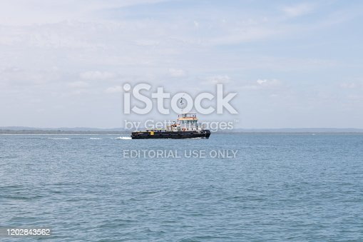 Bahia, Brazil - January 2020: Ship tug in the middle of the ocean. Morro de Sao Paulo, Salvador, Brazil. Hill.