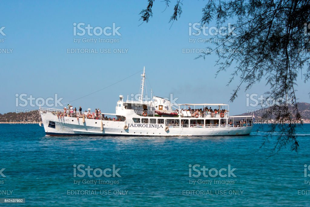 Ship with passengers in Adriatic sea near cost stock photo