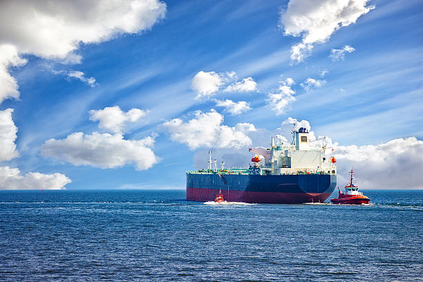 Ship with tugs stock photo