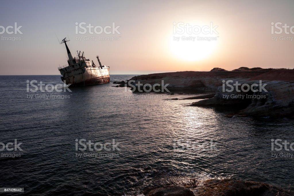 Ship wreck at sunset stock photo