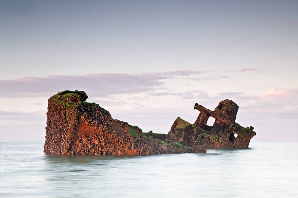 Ship wreck partially sunken shipwreck at sunrise. sunken stock pictures, royalty-free photos & images