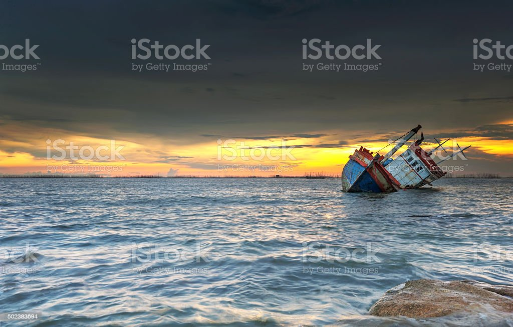 ship wrecked at sunset in Chonburi ,Thailand stock photo